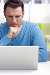 Man reading computer report